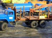 Сортиментовоз Урал 63685 с ГМ Атлант 90